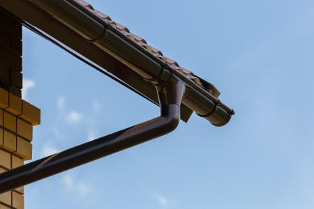 ТН ПВХ МАКСИ колено трубы 67°, коричневое - 10